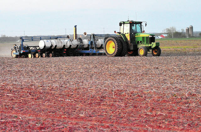 A farmer works to get his crops planted in a field off Washington Road this week. Spring planting season is in full swing and motorists are urged to use caution when driving and watch out for farm equipment on the roadways.