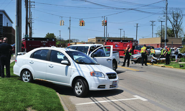 Troy Police, fire, and medics work the scene of a four-vehicle crash on West Water Street near Adams on Wednesday afternoon. Three people were transported from the scene with minor injuries. Troy Police are investigating the crash.