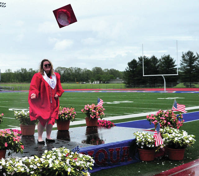 Piqua High School senior Lauren Sweetman tosses her cap after receiving her diploma in ceremonies at Alexander Stadium/Purk Field on Tuesday. Many members of the Piqua Class of 2020 took the opportunity to walk to the stage and receive their diplomas from family members this year. The PHS media department is filming each senior and will put together a program of the 2020 Commencement Ceremony.