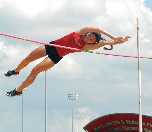 David Fong   Miami Valley Today file Troy's Christine Moser clears the bar in the pole vault at the Division I state meet during her senior season in 2018.