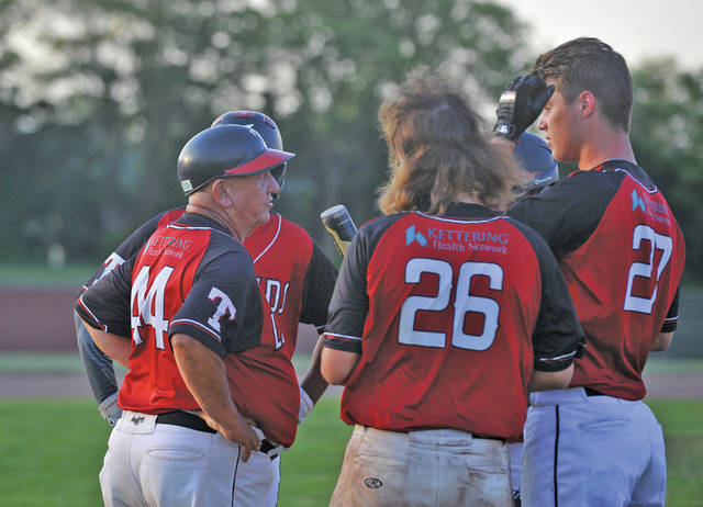 Josh Brown   Miami Valley Today file Troy Post 43 coach Frosty Brown talks with players on the field during a game last year.