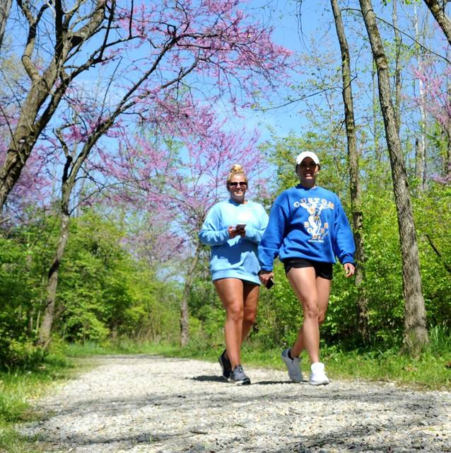 Two women took advantage of sunny skies and favorable temperatures to walk the trails of Greenville Falls near Covington.