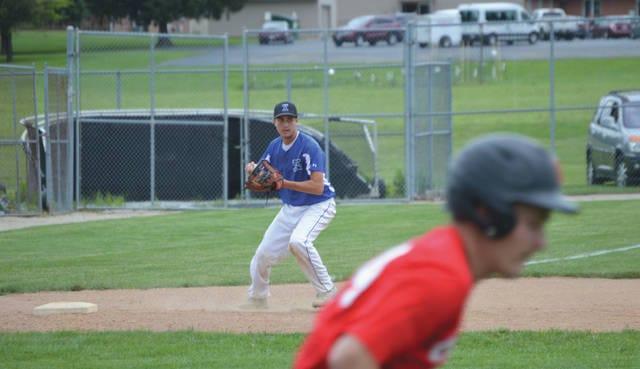 Xenia third baseman Logan Bilbrey sets to throw to throw out a Bellefontaine runner heading to first during Monday's ACME Baseball Congress summer high school league game on the Xenia High School baseball diamond. Bellefontaine won the game, 4-3.
