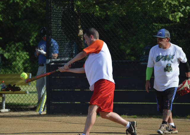 A batter for the White Sail Inn-sponsored Men's D League team smacks a softball for a double, during a 6 p.m. Friday game with the Funk/Liberty Tax/Bowl 10-sponsored team, at Beavercreek's Rotary Park.