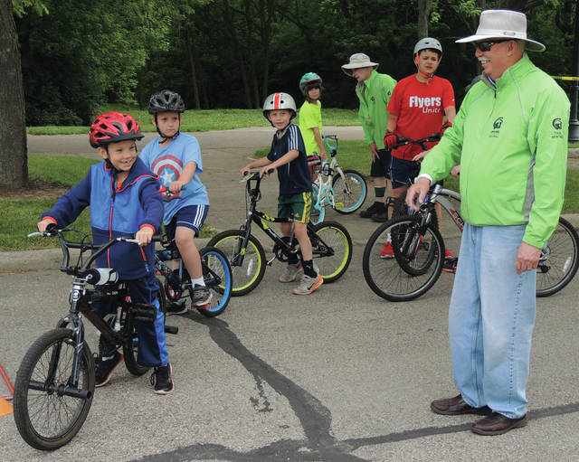 Submitted photos GCP&T Trail Sentinel and Certified Cycling Instructor Richard Tool, far right, leads a group bike campers on a skills test to teach safety as well as rules of the road.