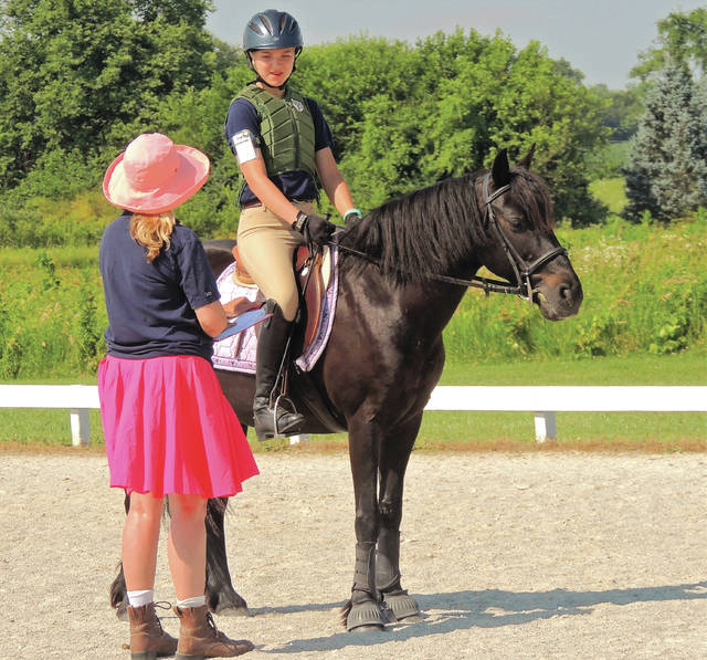 Submitted photos Younger riders learn the basic skills from older Hunter's Run Pony Club members.