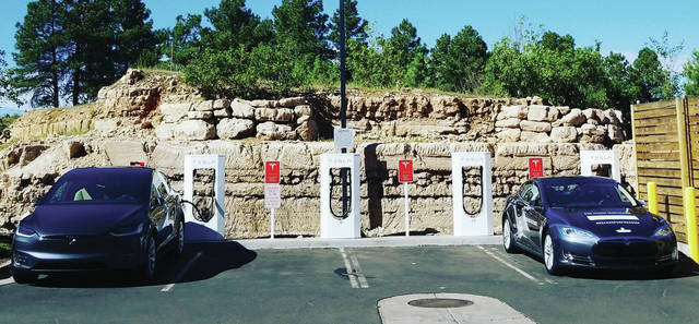 The pair had to stop and charge the electric vehicle every three hours.
