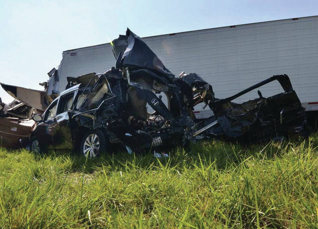 AP photo A van sits among other vehicles involved in a deadly crash on the westbound Interstate 70 near Terre Haute, Ind., on July 18.