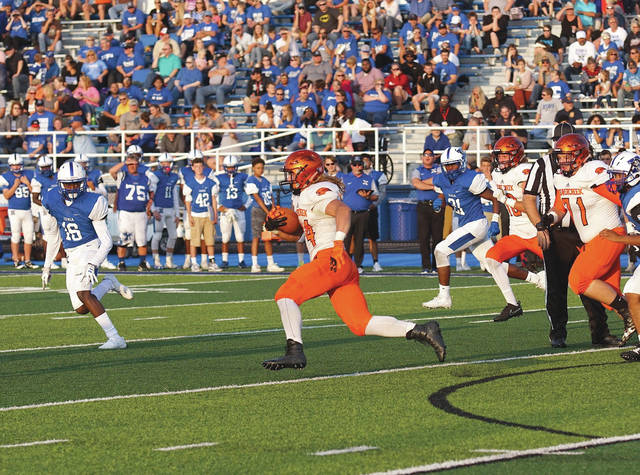 Beavercreek senior fullback Kaden Wenger runs through the Xenia defense for a big gain. Wenger led the Beavers with 173 yards rushing on 25 carries and two touchdowns in Beavercreek's 35-6 win, Aug. 24 at Doug Adams Stadium in Xenia.