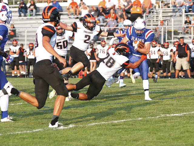 Griffin Mangan (9) hauls in a pass from Greeneview quarterback Nick Clevenger for a 33-yard gain, Friday Aug. 25 at Don Nock Field in Jamestown. The host Rams defeated Arcanum, 31-0, in the high school football season opener for both schools.