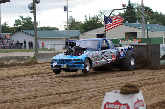 Marshal Foiles, of Xenia, powers his Kickstart My Heart Chevy S-10 pickup down the clay strip to a pull of 287 feet 3 inches, Friday Aug. 4 at the Greene County Fairgrounds in Xenia.