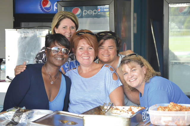 Xenia High School football moms (left to right) Rochele Burnette, Jen Wilson, Cheri Lockwood, Tami Bartlett and Lissa Kadel were on hand in the concession stand to serve the Buccaneers players sandwiches between Wednesday's Aug. 9 two-a-day practices at Doug Adams Stadium in Xenia.