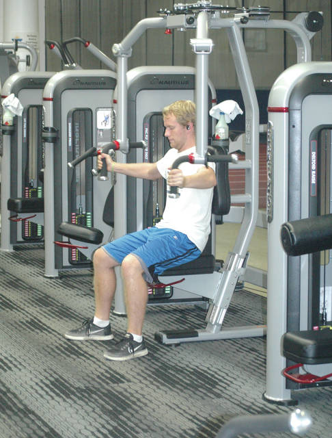Scott Halasz | Xenia Gazette A Cedarville University student works out on one of the new nautilus machines inside the fitness center.