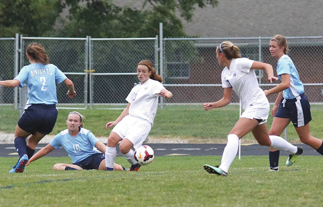 Freshman Josie Faris (13) shown here faking out a pair of Xenia Legacy Christian defenders and passing off to a Greeneview teammate, scored three goals and assisted on two others in the host Rams' 8-0 win over the Knights, Sept. 2 at Don Nock Field in Jamestown.