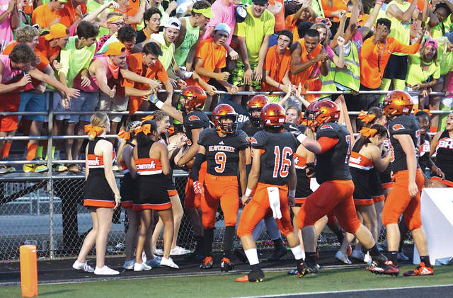 Junior wing back Sebastian Rendon celebrates with some Beavercreek students after his 57-yard touchdown run in the first half of Friday's Sept. 22 high school football game with Kettering Fairmont. Beavercreek won 14-3 to remain unbeaten at 5-0 this season.