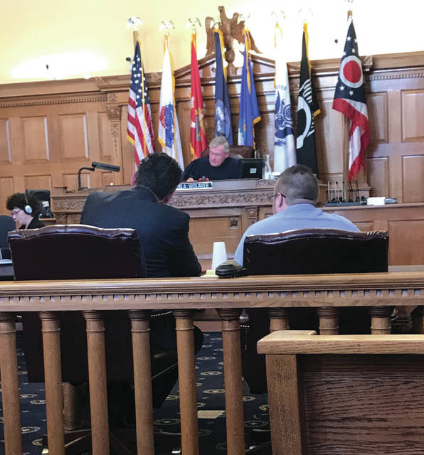 Anna Bolton | Greene County News Defense attorney Patrick Mulligan (left), defendant Dakota Lacey and Judge Stephen Wolaver wait as a witness approaches the stand.