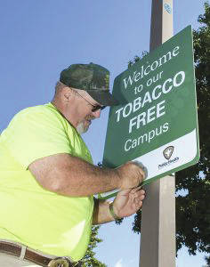 Don Zink, Grounds Maintenance lead, installs one of the 46 welcome signs donated by Public Health – Dayton & Montgomery County.