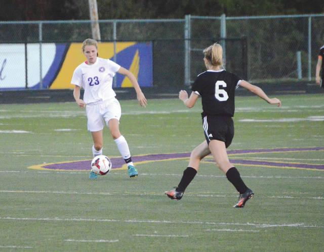 Sophomore forward Bailey Sedlak (23) drives downfield against Franklin in this file photo. Sedlak and the Bellbrook Golden Eagles took on Mariemont in a Division II district championship match, Oct. 26 at Lakota West High School in West Chester.