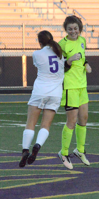 Bellbrook senior goalie Bekah Vine, shown greeting teammate Chloe Crompton (5) prior to a match earlier this year, was named the Southwestern Buckeye League's Southwestern Division Player of the Year.