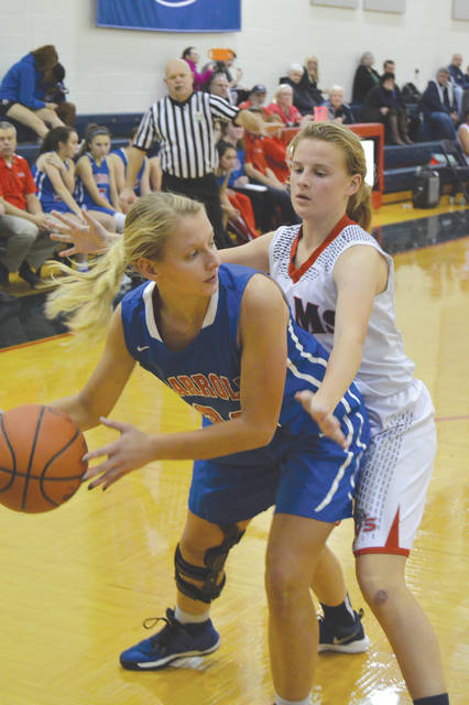 Carroll's Eve Thorner looks to pass inside during the fourth quarter of Tuesday's Nov. 28 girls high school basketball game at Miami Valley School, in Dayton. Carroll defeated a very young Miami Valley squad, 61-9.