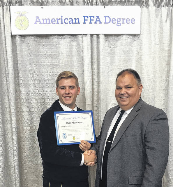 Submitted photo Cody Myers from Jamestown was awarded the American FFA Degree at the recent National FFA Convention in Indianapolis. Cody is involved with the Greeneview chapter of FFA and is in his second year at Ohio State ATI in Wooster. He plans on attending Ohio State's main campus next year while majoring in agricultural education. Pictured with Cody is Greeneview/Career Center chapter advisor Doug Wickline.