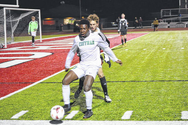 Dublin Coffman senior midfielder Emeka Eneli (10) chases down a ball, as Beavercreek's senior defender Mark Rzecznik defends, during Division I state semifinal first-half action at Powlus Field in London.