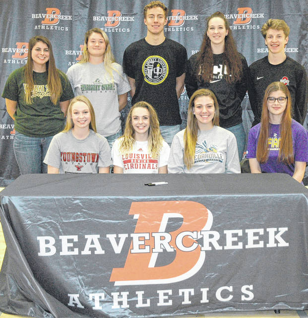 Scott Halasz   Greene County News Several Beavercreek athletes signed their National Letters of Intent during a ceremony at the high school Nov. 8. Front row (left to right) Averi McCarthy, Rosalie (Rosie) Devine, Lexi Moore, and Sara Skaggs. Back row (left to right) Natasha Price, Raidyn Johnson, Jon Alessandro, Haley Hutchins, and Parker Mikesch.