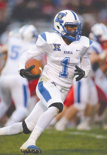 All-District first-team offensive pick Meechi Harris of Xenia was a threat to score whenever he had the ball. Harris, shown here snaring an interception against Troy, was the Bucs' best wide receiver and was a dangerous kick returner as well.