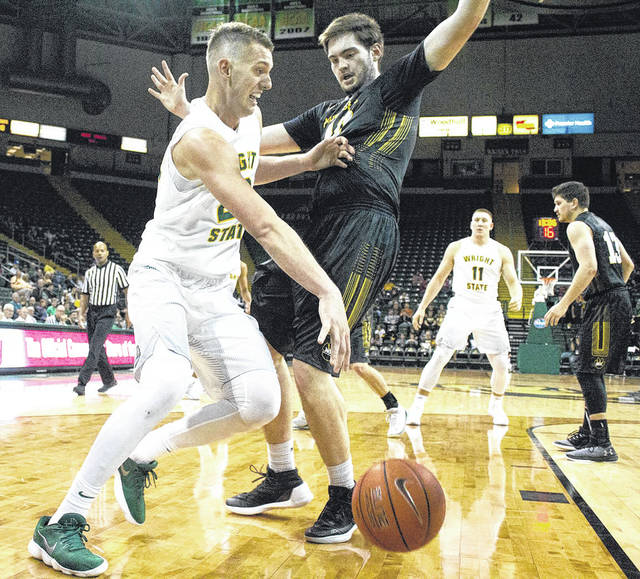 Submitted photo Wright State University junior center Parker Ernsthausen (left) had a breakthrough season last year and is looking to create more offense this year.