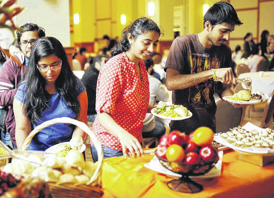 Submitted photo Cedarville University students will serve at a free Thanksgiving dinner for international students from local universities.