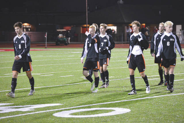 Beavercreek players, from left to right, Joshua Fleck, Ryan Bernt, Jonah Ackerson, Mark Rzecznik, Vincent Peden and Hunter Jackson walk off the Bowlus Field turf after a scoreless first half against Dublin Coffman in the state semifinal match. Fleck would later score the winning goal off Ackerson's corner kick to win the match, 1-0, in double overtime.