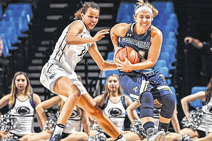 Submitted photos Senior guard Katilyn Holm (right) tries to keep control of the ball.