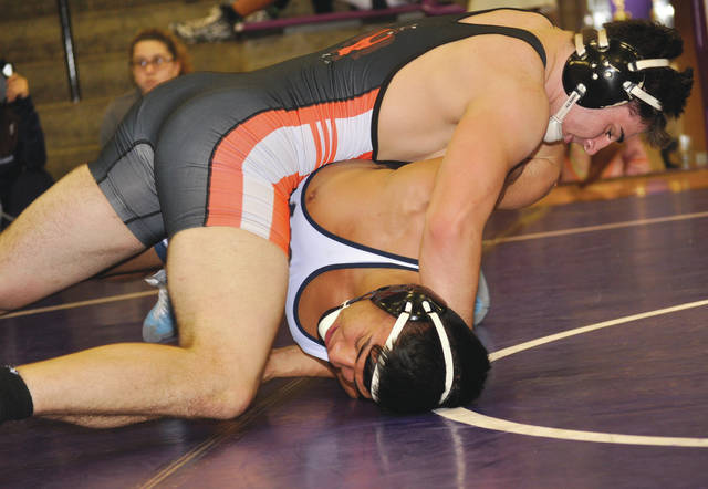 Wrestling in the 182-pound weight class, Beavercreek's Reece Blackmore pins Luis Ceron, of Louisville (Ky.) Moore Traditional, in 1 minute, 8 seconds during the Elder Duals wrestling tournament, held Dec. 2 in Cincinnati.