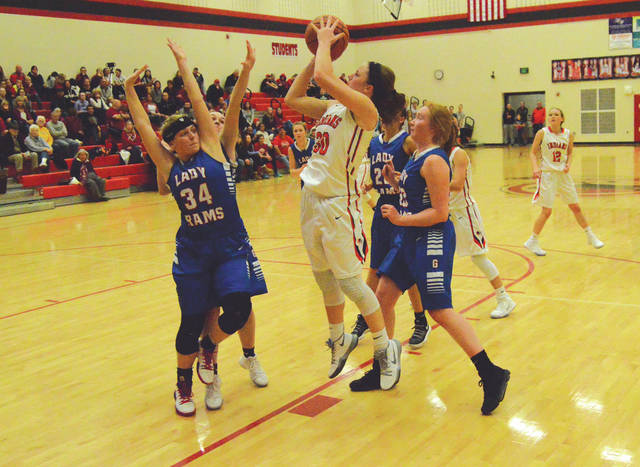 Cedarville senior guard Maggie Coe (30) puts up a shot while surrounded by four Greeneview Rams, during the first half of Thursday's Dec. 21 Ohio Heritage Conference girls high school basketball game in Cedarville. Coe led the victorious Indians with a game-high 21 points scored.