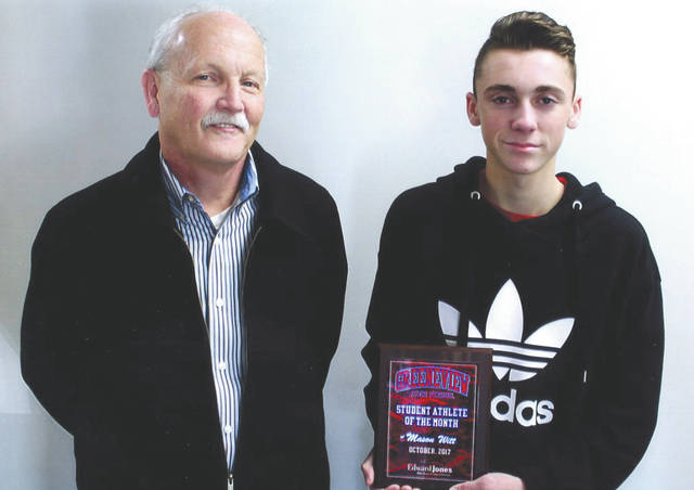 Mason Witt, right, shown here with Mike Reed, was chosen as the Edward Jones Investments Athlete of the Month for October for Greeneview High School. This award is being sponsored by the office of Mike Reed at Edward Jones Investments of Xenia, serving Xenia, Jamestown, Cedarville and surrounding areas. Mason, a freshman on the boy's golf team team, finished the season with an average of 35, was a first team all-Ohio Heritage Conference selection and was the No. 1 individual qualifier in the Southwest sectional. He was the No. 2 individual qualifier in the Southwest district and finished second in the state as one of only two boys to finish under par at the state tournament. He was also selected for First team all-state. His grade-point average is a 3.746.