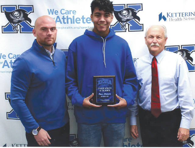 Omar Ahmouda, center with Xenia High School Athletic Director Nathan Kopp (left) and Mike Reed, was chosen as the Edward Jones Investments Athlete of the Month for October for Xenia High School. This award is being sponsored by the office of Mike Reed at Edward Jones Investments of Xenia, serving Xenia, Jamestown, Cedarville and surrounding areas. Ahmouda, a senior on the boy's soccer team, is an excellent example of a student leader at Xenia High School. His excellence on the soccer field is accented by his leadership and hard work in the class room. His positive energy is contagious!