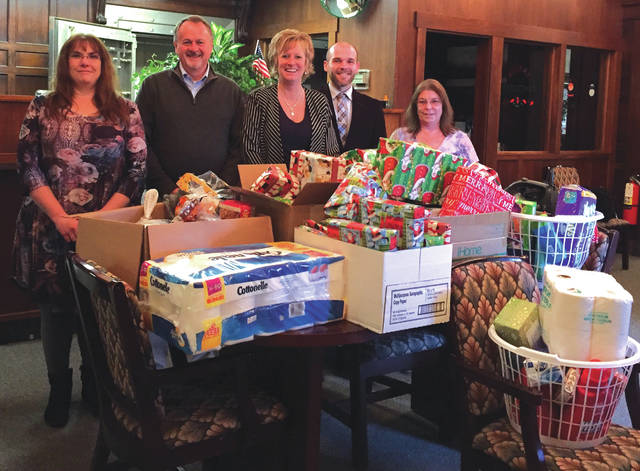 Submitted photo Deputy Treasurer Christy Combs, Greene County Treasurer Dick Gould, Chief Deputy Treasurer Sandy Brubaker, Chief Deputy Recorder Andrew Williams and Deputy Treasurer Yvette Lynch collected clothes and toys for a Xenia family.