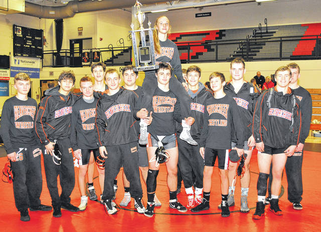The Beavercreek High School wrestling team (Greene County) hoists the Battle for the County Line trophy after Thursday's Jan. 4 win over Fairmont (Montgomery County). Since The Battle first began in 2009, Thursday's win at Beavercreek High marks the first time that one of the two schools repeated as champions.