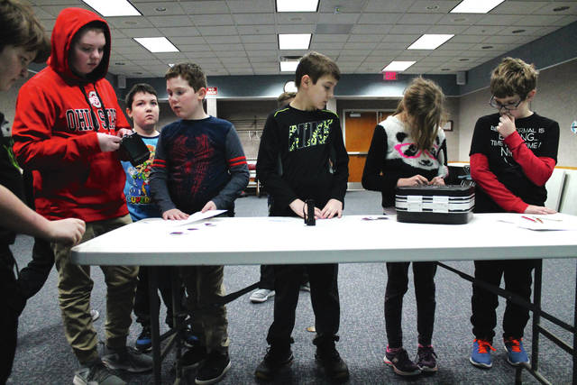 "Anna Bolton | Xenia Gazette Local kids used puzzles to ""break out"" of a Xenia Library room during an escape room program Jan. 17. Working together under a ticking clock, the group of kids, aged 10-18, solved various riddles in the Minecraft world to figure out combinations, open locks, and break into two game boxes. Greene County Public Library offers other programs throughout the month, which can be found on its website."