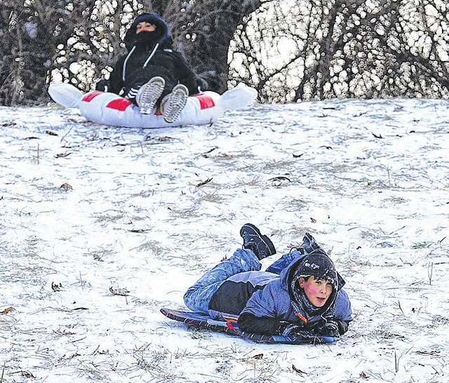 Barb Slone | Xenia Gazette Several children got a chance to enjoy the winter snow at Hawkins Hill on Fairgrounds Road recently. The cold didn't stop them from speeding down the hill.