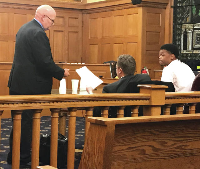 Anna Bolton | Xenia Gazette Bailiff Ron Mellotte hands the verdict forms to Defense Attorney Travis Kane and defendant Myron Walker. A year prior, on Jan. 12, 2017, a jury found Walker not guilty of two counts of rape and could not reach a verdict on gross sexual imposition, all three charges in a different case.