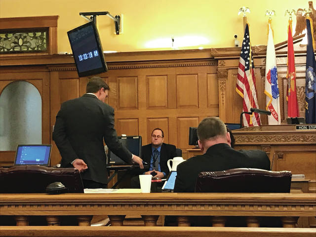 Anna Bolton | Xenia Gazette Assistant Prosecutor David Morrison questions Detective Gilbert on the stand during trial Jan. 24 as Detective Shawn Bradley listens.