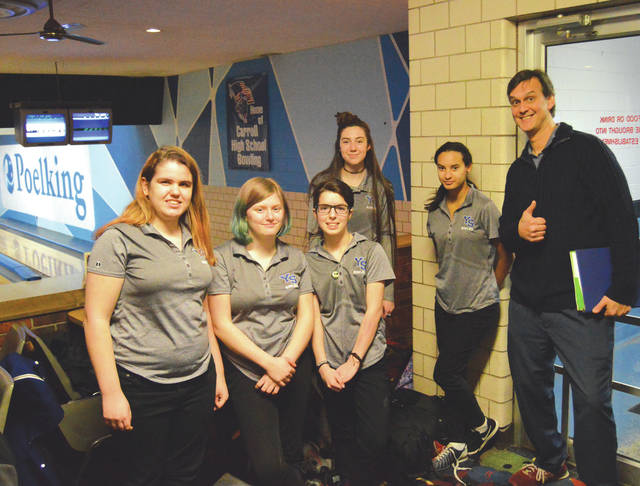 Members of the Yellow Springs High School girls varsity bowling team posed for a team photo after a narrow loss to Carroll, Jan. 30 at Poelking Lanes in Dayton. According to their coach, this is the first time in school history Yellow Springs has had a girls varsity bowling team. Team members are: Sierra Ward, Zoe Clark, Stephanie Burks, Kallyn Buckenmyer, Emily Ranard and coach Matt Cole.