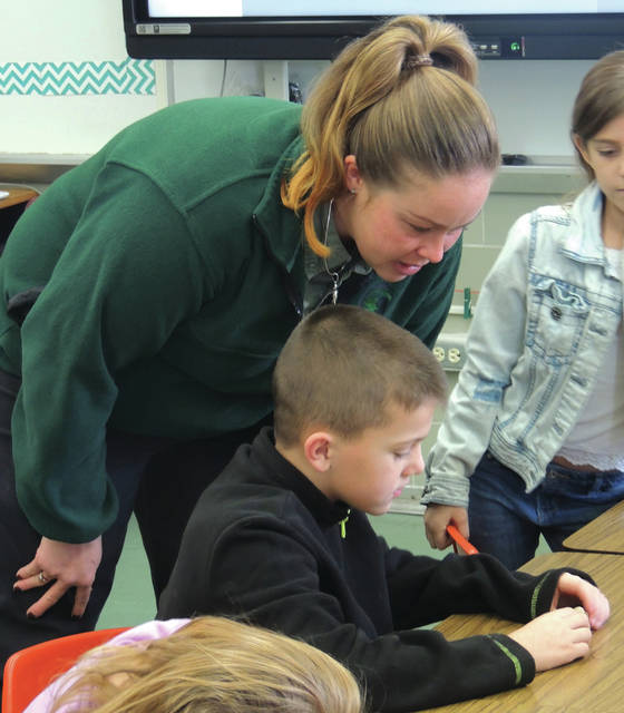 Submitted photos Greene County Parks & Trails Naturalist Ashlee Schmitt presents a program on fossils at Greeneview Elementary School.