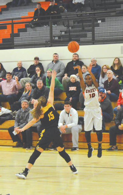 Beavercreek's Carmen Williams (10) launches a 3-pointer over Centerville's Kenzie Smith in Wednesday's Feb. 7 girls high school basketball game in the Ed Zink Fieldhouse in Beavercreek. Williams scored a game-high 20 points in the 47-32 win.