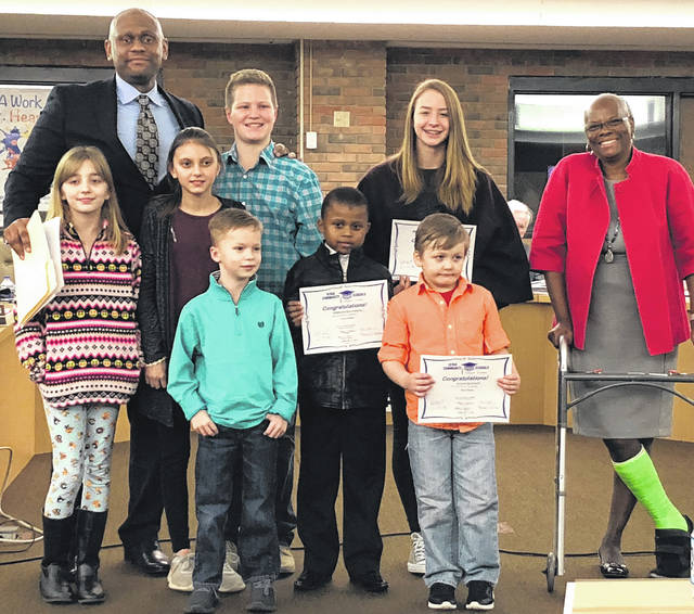 Scott Halasz | Greene County News Xenia's school board recognized Kids of Character for February at its recent meeting. Pictured with Superintendent Dr. Gabe Lofton and Board President Cheryl Marcus are Anna Denton (Cox), Kaylee Benson (Warner), Kyhler Baker (Tecumseh), Gunnar Stephan (Tecumseh), Ephraim Mulindilwa (Shawnee), Heidi Alex (high school), and Julian Burnett (McKinley). Recognized but not pictured is Louella Bond from Xenia Preshool.