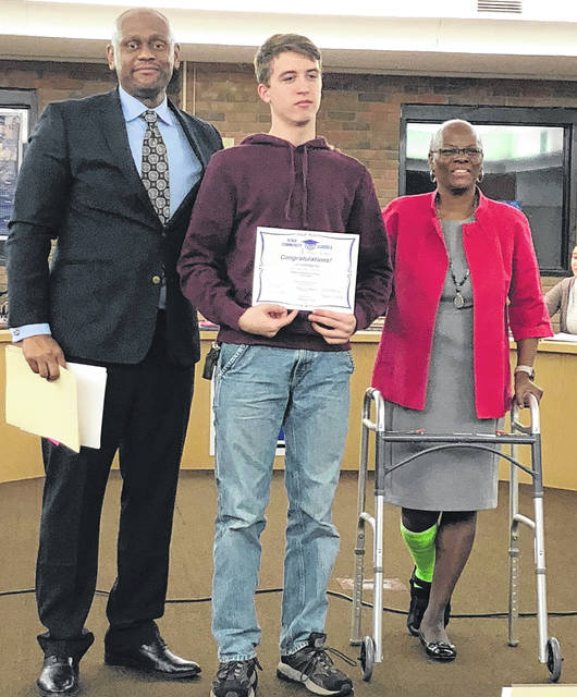 Scott Halasz | Greene County News Xenia student Ian Soderquist was honored by the Xenia board of education for finishing first in the region as a member of Business Professionals of America. He is pictured with Superintendent Dr. Gabe Lofton and Board President Cheryl Marcus. Also recognized but not pictured is Isabell Tettau.