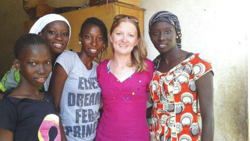 Submitted photo Jacquelyn Weaver, who graduated from Wright State in 2014 with degrees in religion and political science, spent 17 months as a volunteer with the Peace Corps in the west African nation of Senegal. She is pictured with her training host family.