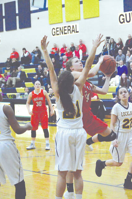 Cedarville junior post player Ruby Stack (34) goes in for an inside shot attempt, during the Division IV sectional semifinal game against Lockland, Feb. 22 in Monroe. Cedarville won the game, 50-21.