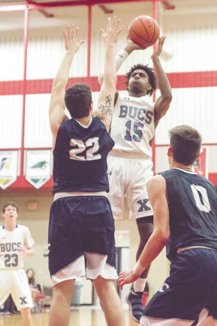 Samari Curtis (15) puts up a shot during Saturday's Feb. 24 first round boys high school sectional basketball tournament game against Fairmont, at Trotwood-Madison High School. Xenia lost the Division I opener, 89-57.
